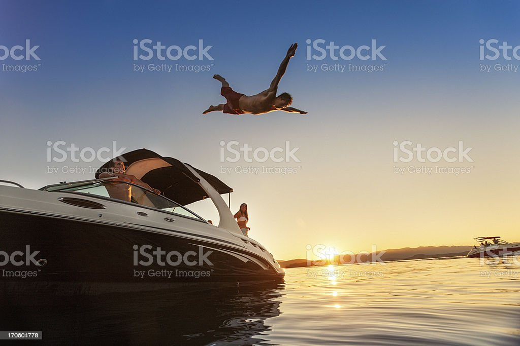 Summer Boating Sunset Jump stock photo