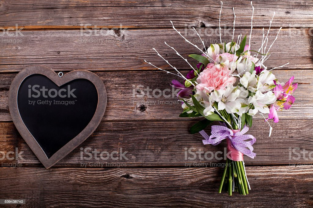 Summer bouquet from gillyflowers and alstroemeria on old wooden stock photo
