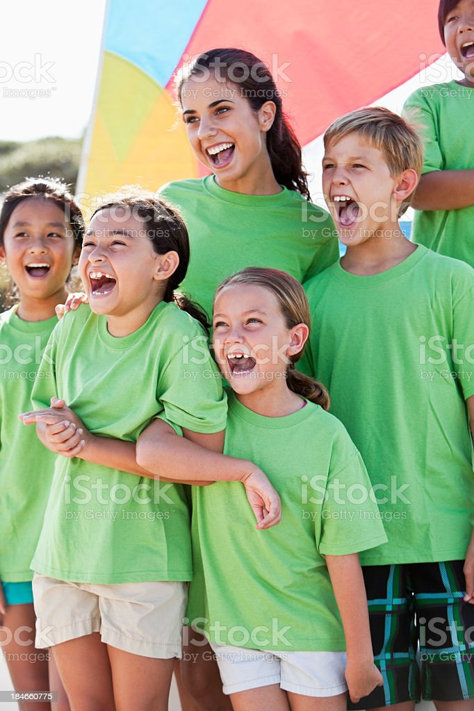 Summer camp counselor with group of children stock photo