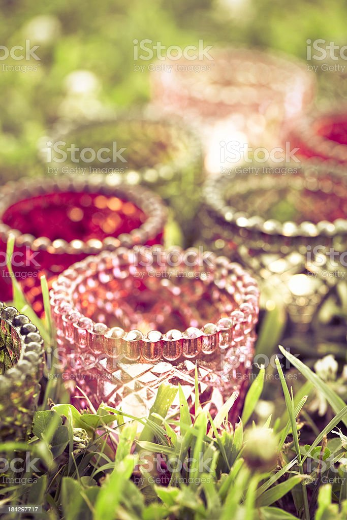 Summer Candles in Grass royalty-free stock photo