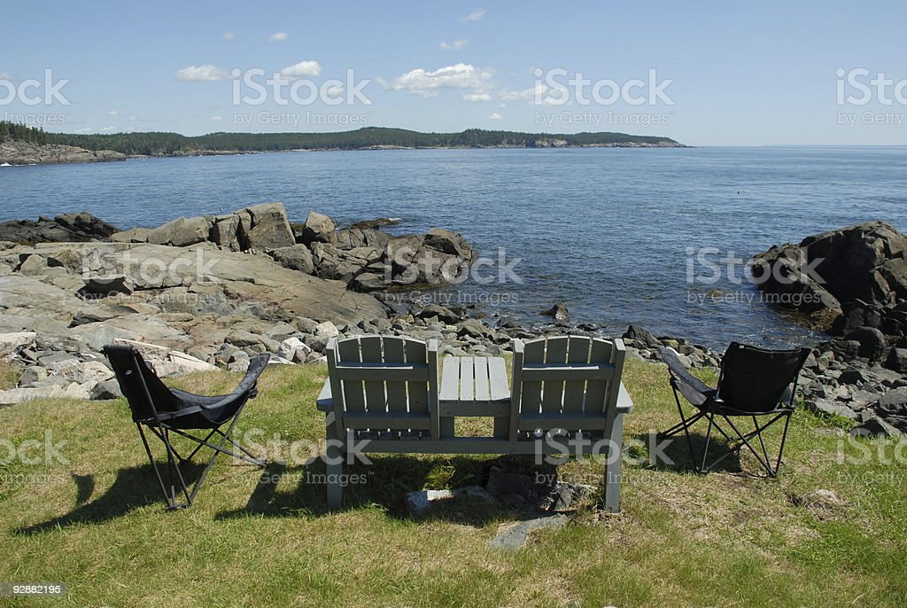 Summer chairs overlook the New England coast stock photo