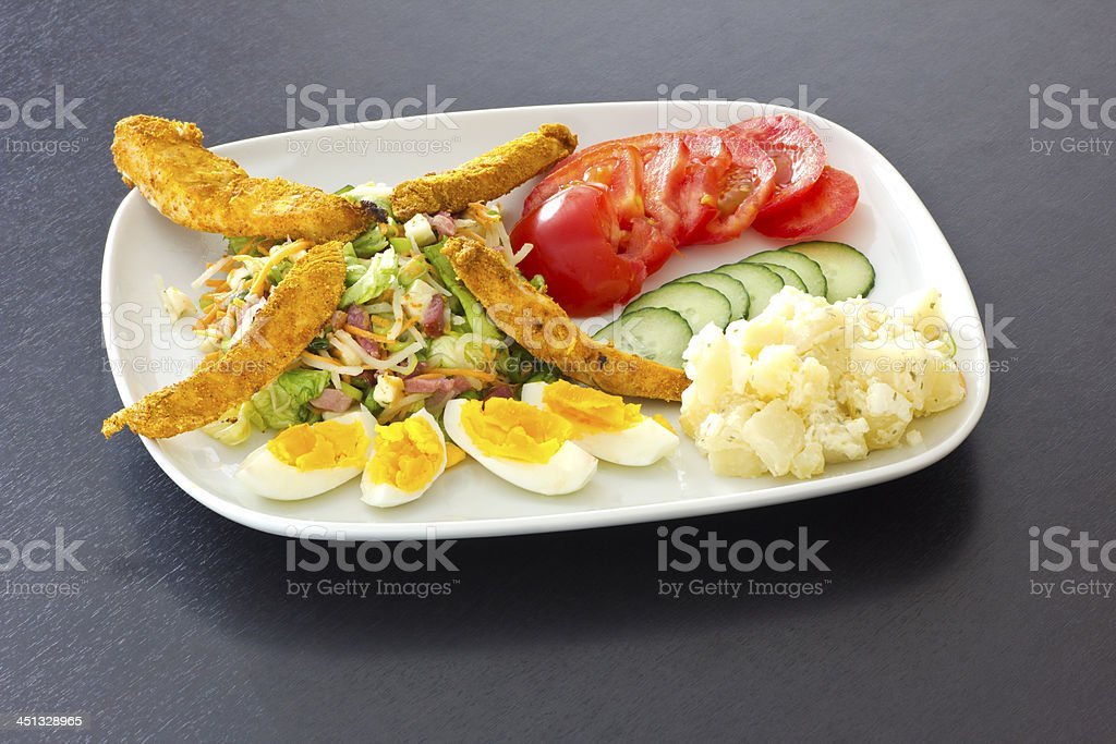 summer chicken salad dish stock photo