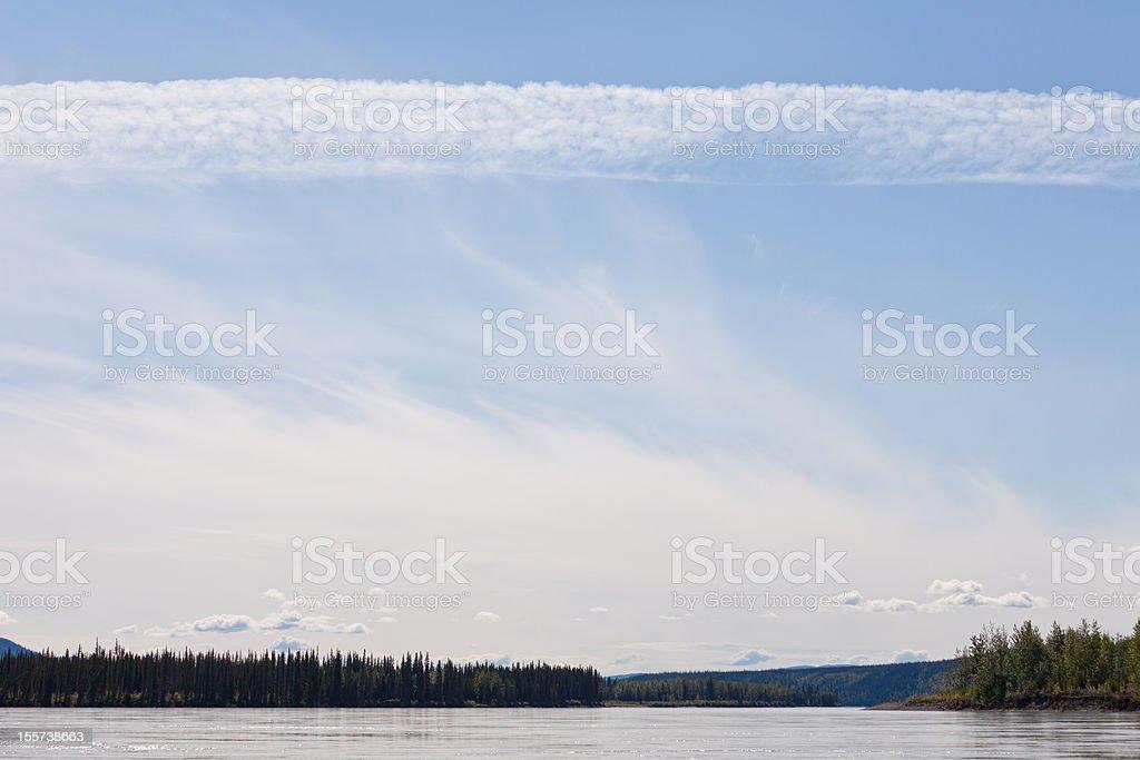 Summer cloud sky over Yukon River near Dawson City royalty-free stock photo
