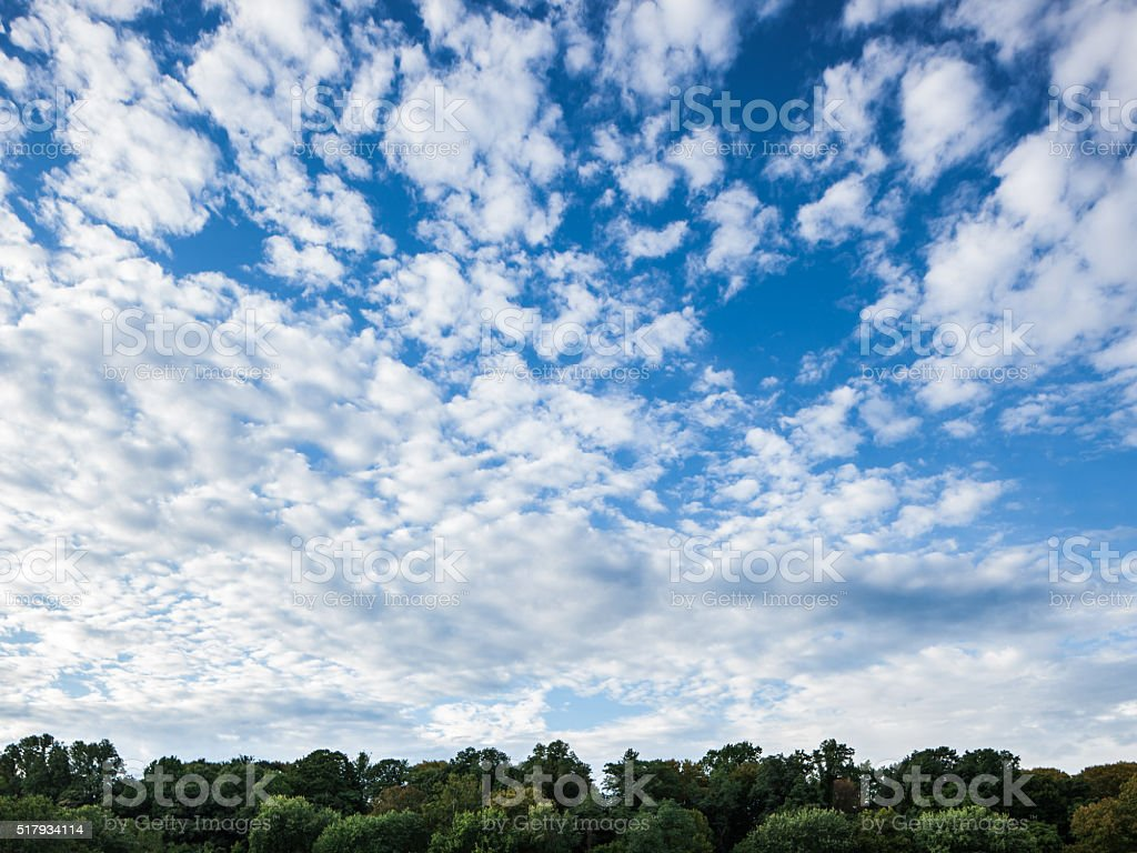 Summer cloudscape with blue sky and horizon stock photo