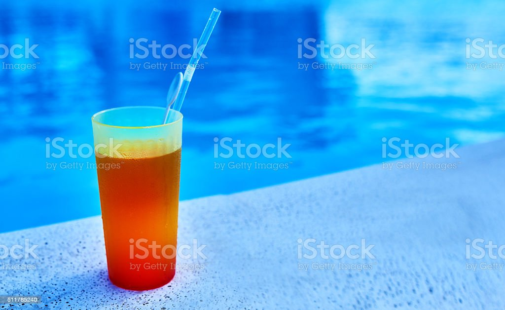 summer cocktail near swimming pool stock photo