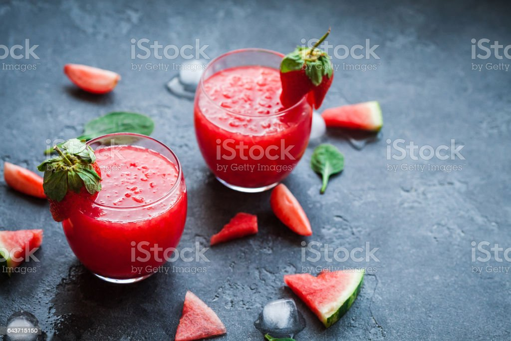 Summer cocktail with watermelon and strawberry on stone background stock photo