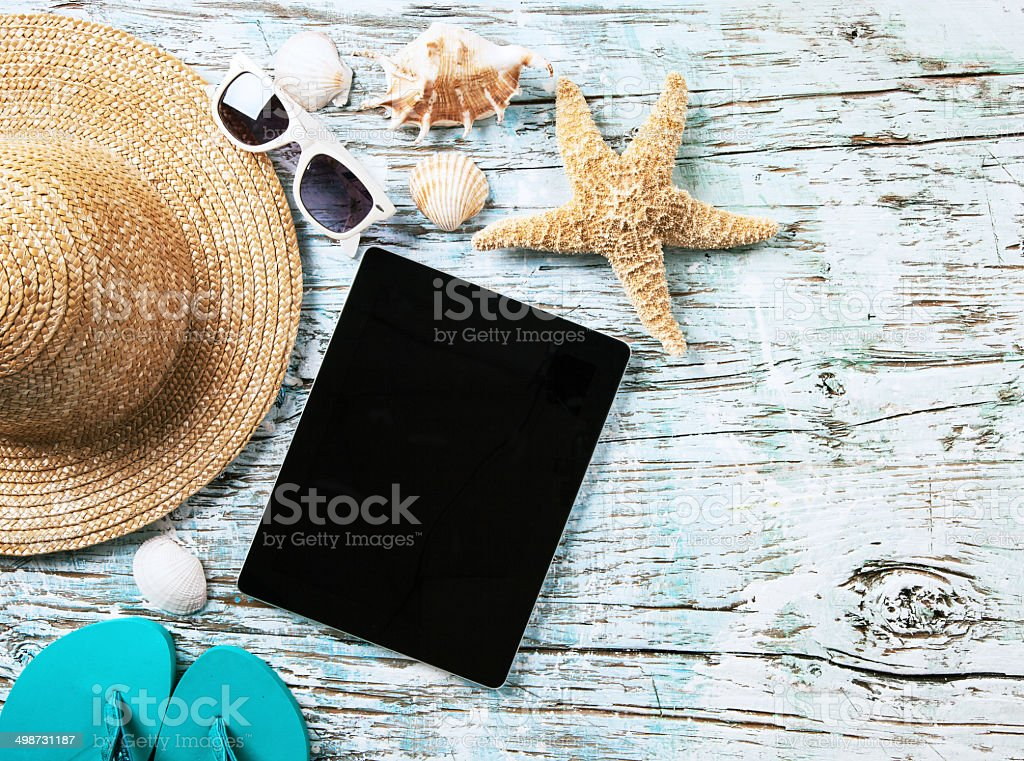 Summer concept with tablet and accessories stock photo