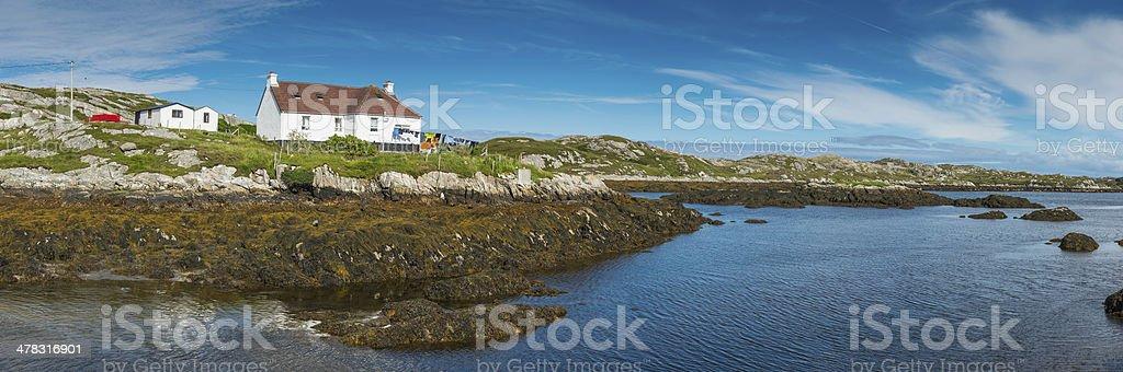 Summer cottage overlooking blue ocean panorama on remote island peninsula stock photo