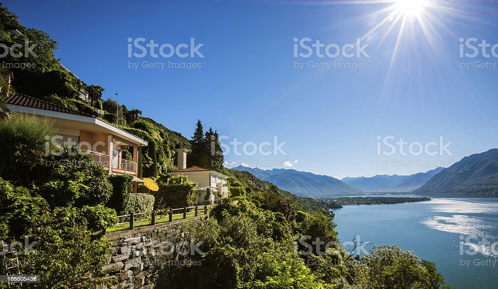 Summer cottages on a cliff at Lake Maggiore in Switzerland stock photo