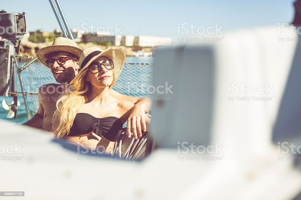 Summer days: couple on a sailing yacht stock photo