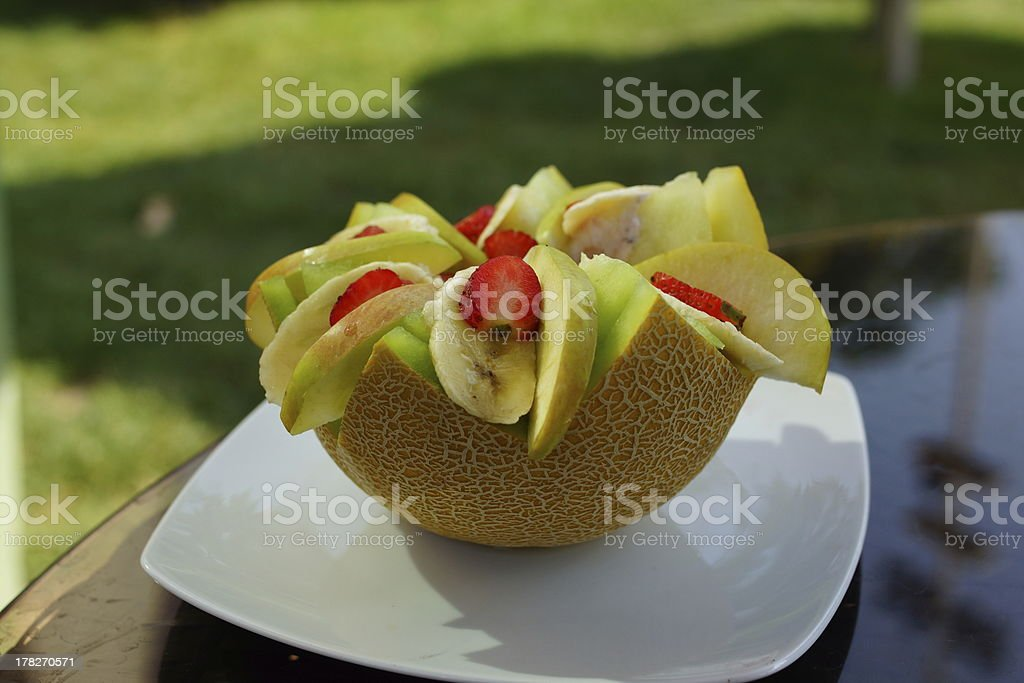 Summer Dessert with melon, strawberries, pears and bananas stock photo