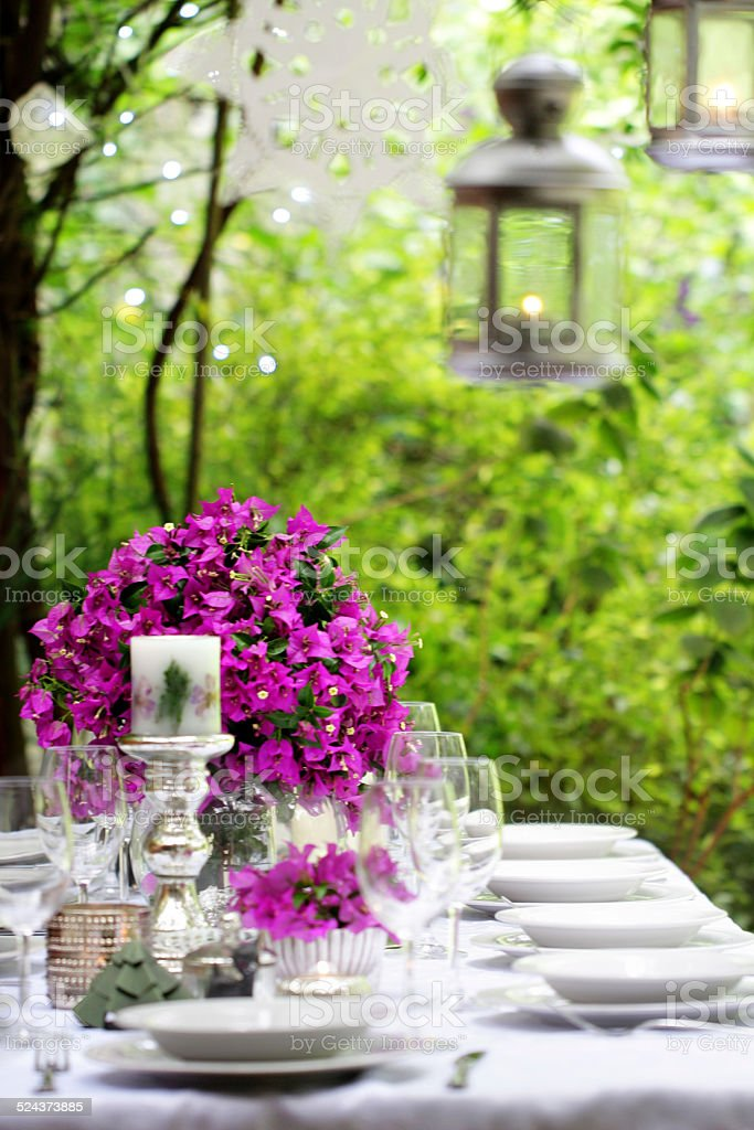 Summer dinner party table setting decoration stock photo