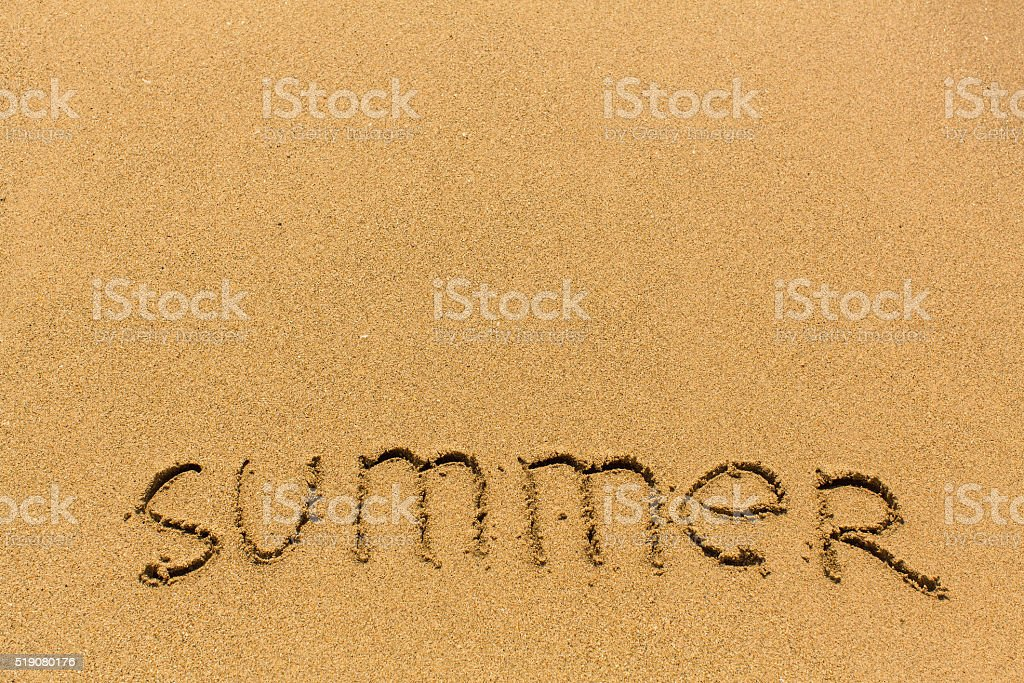 Summer - drawn on the sand of a sea beach. stock photo