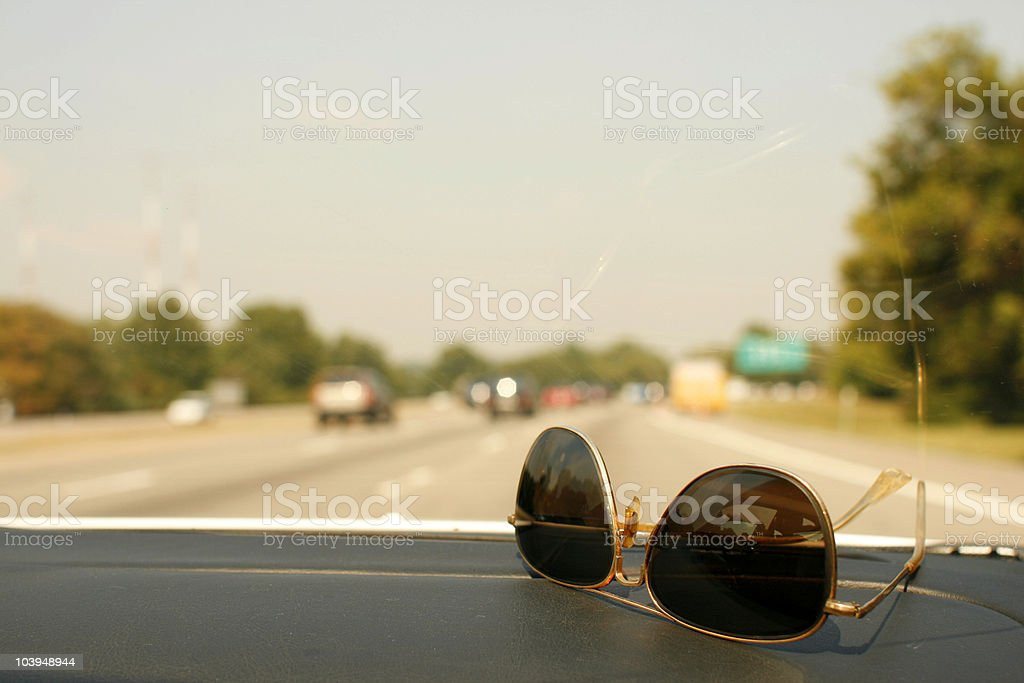 Summer Driving - Aviator Sunglasses on Dashboard royalty-free stock photo