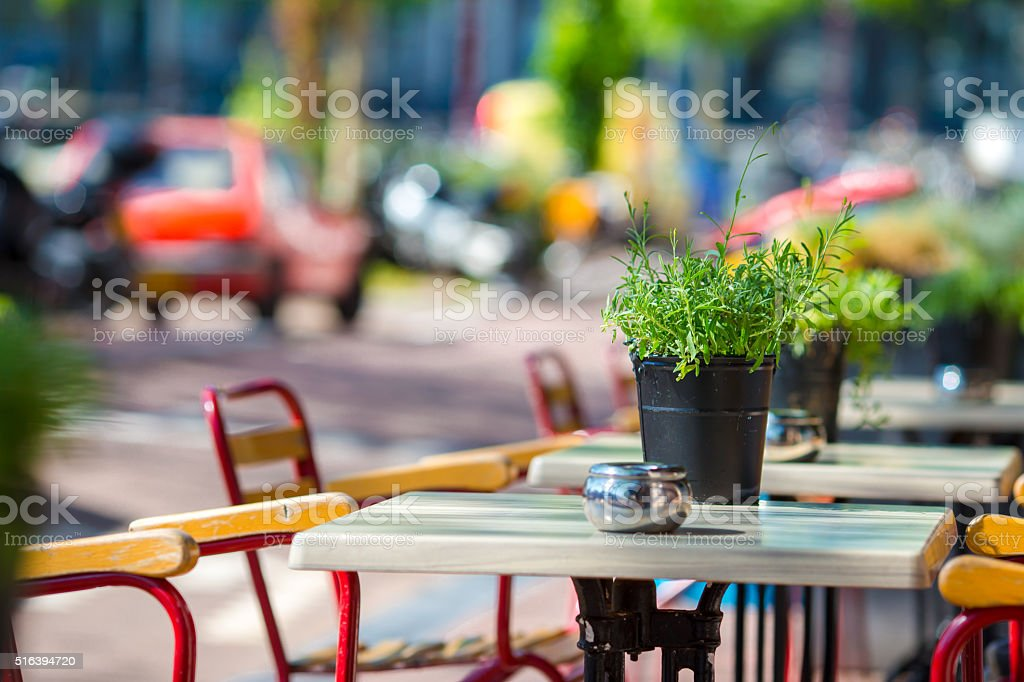 Summer empty outdoor cafe at tourist european city stock photo
