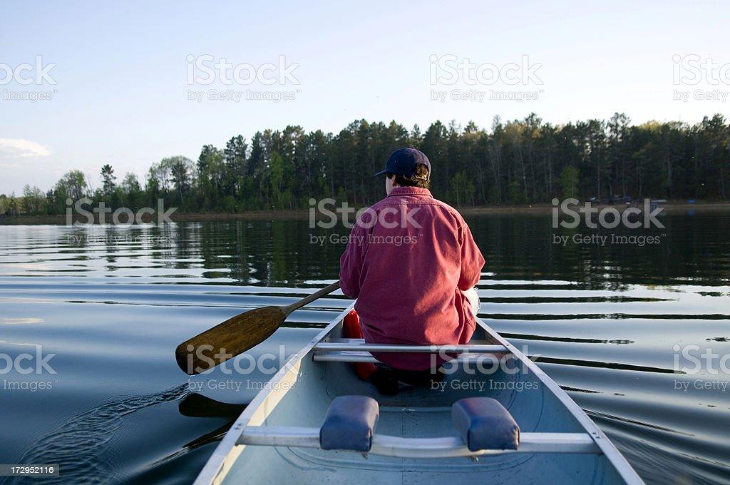 Summer evening canoeing royalty-free stock photo