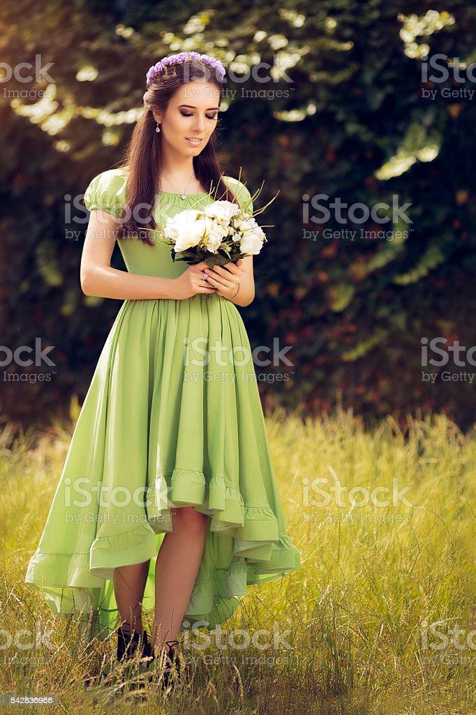 Summer Fairy Girl Holding  Flower Bouquet stock photo
