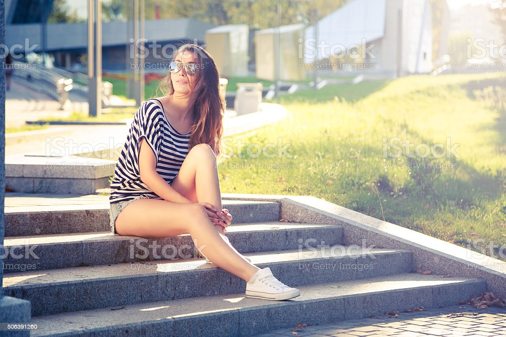 Summer Fashion Hipster Girl Relaxing in City stock photo