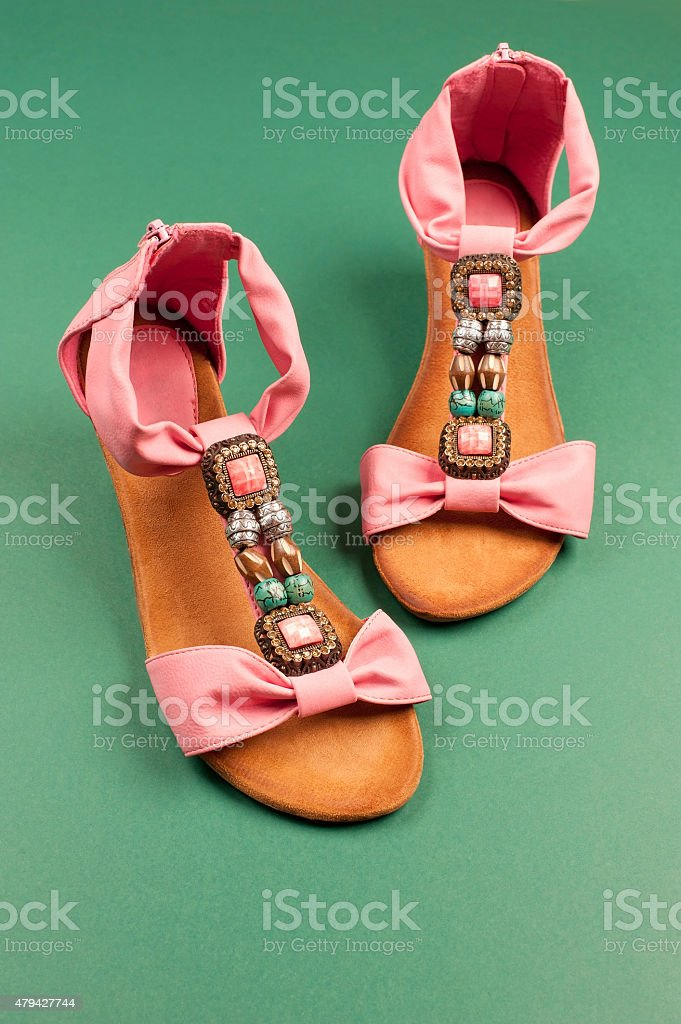 Summer Fashion in Pink on Green background stock photo