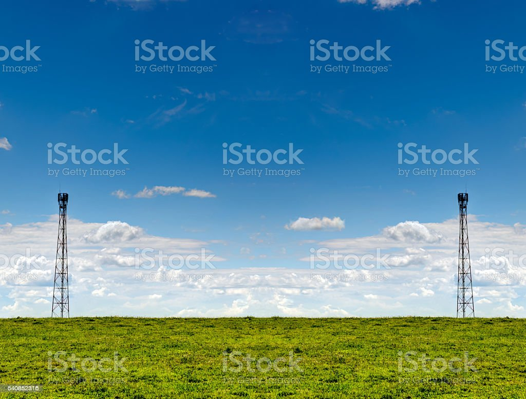 Summer Field Landscape And Telecommunication Towers stock photo