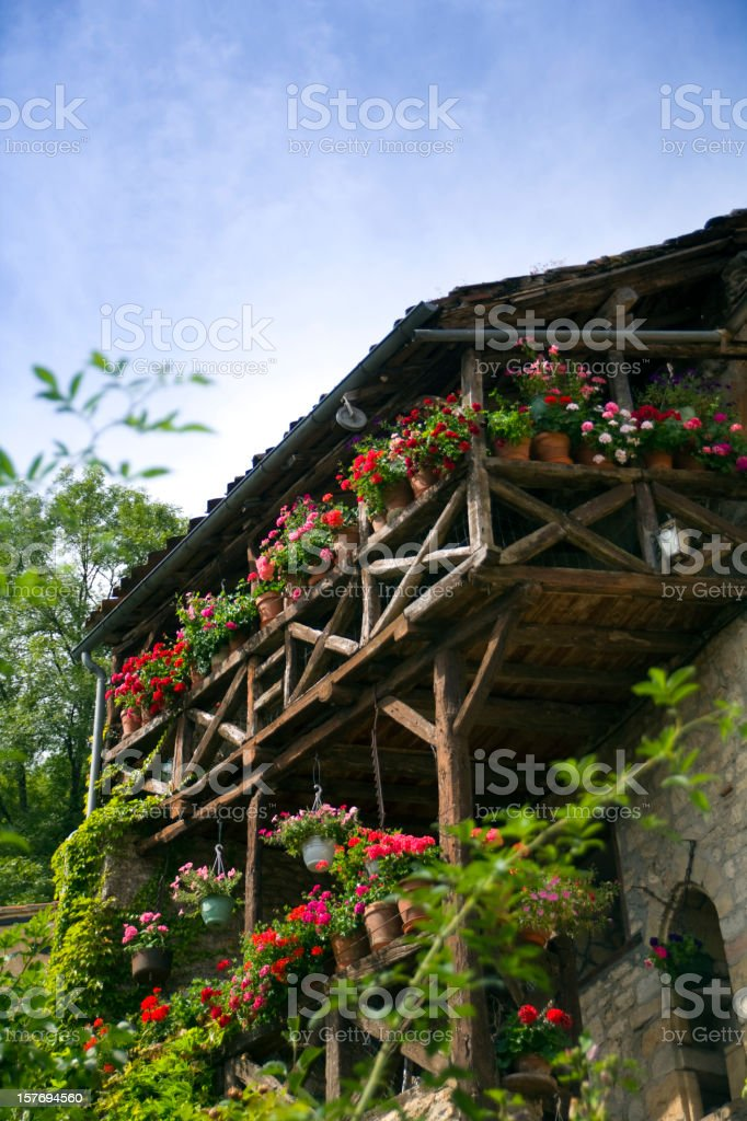 Summer flower balconies in St Cirq Lapopie, Lot Valley, France stock photo