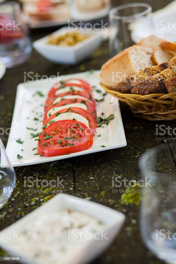 Summer food on table in the park stock photo
