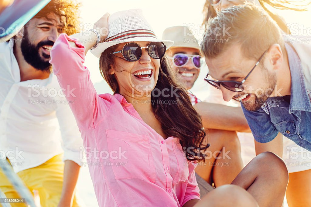 Summer friends on a sea trip stock photo