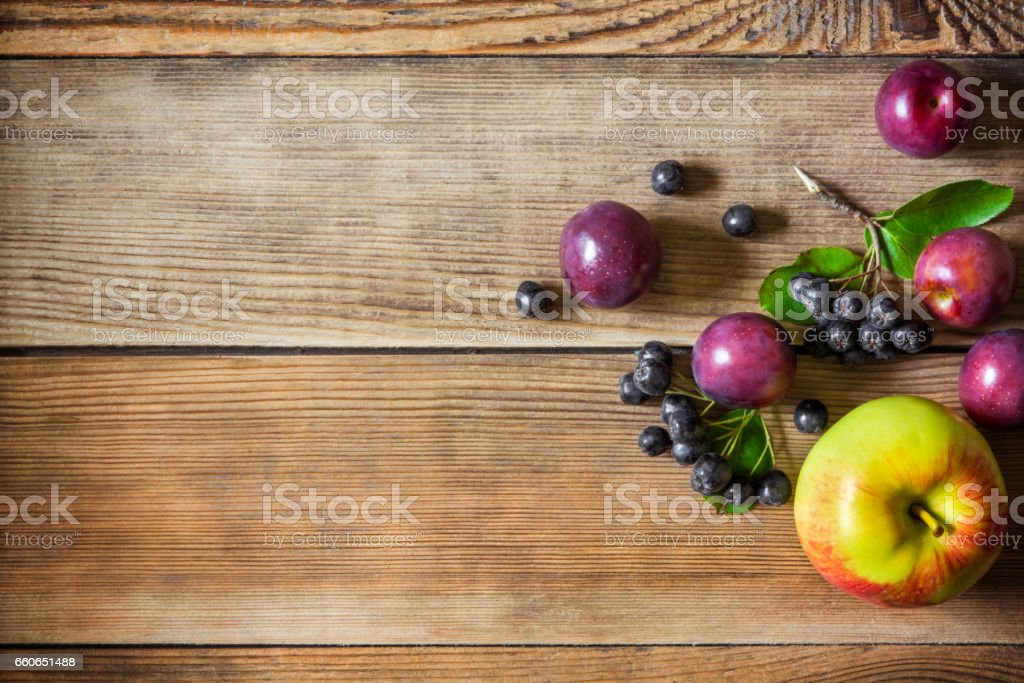Summer fruits on wooden background stock photo
