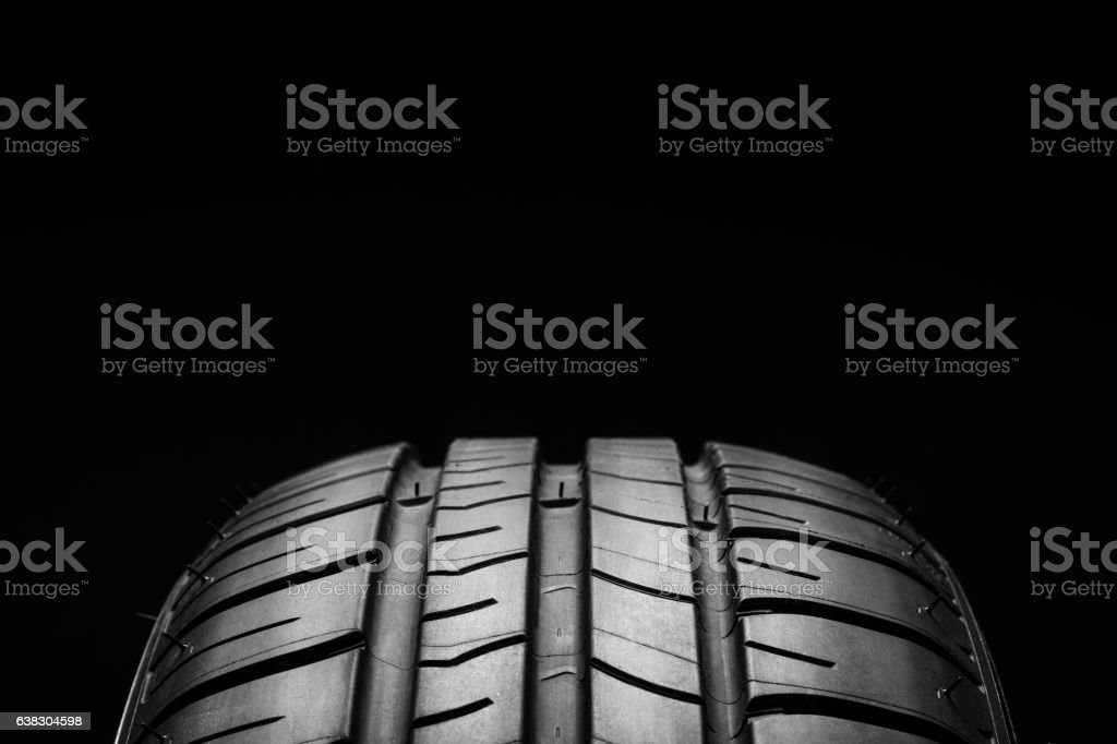 Summer fuel efficient car tires on black background stock photo