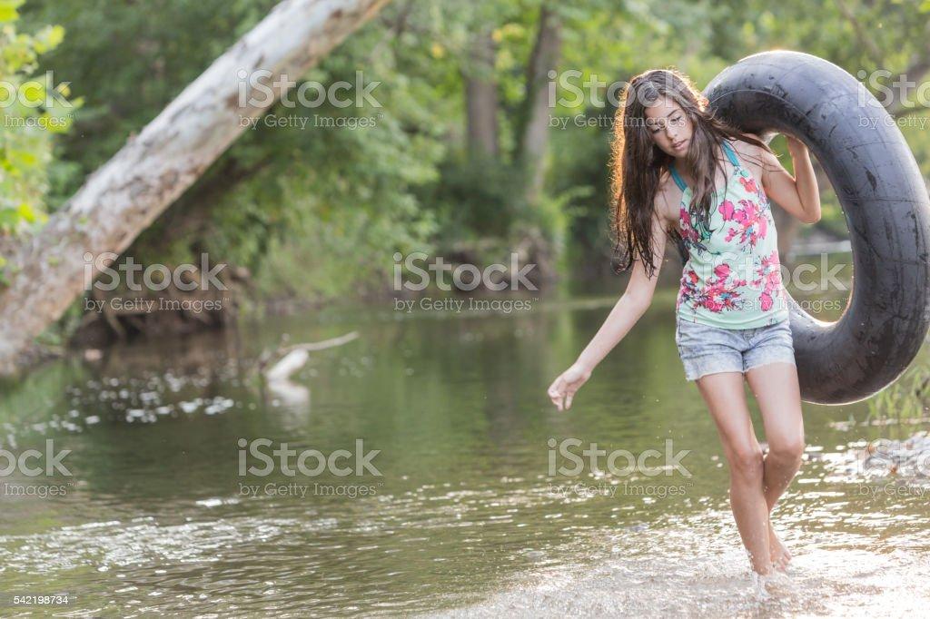 Summer Fun Girl Tubing In River stock photo