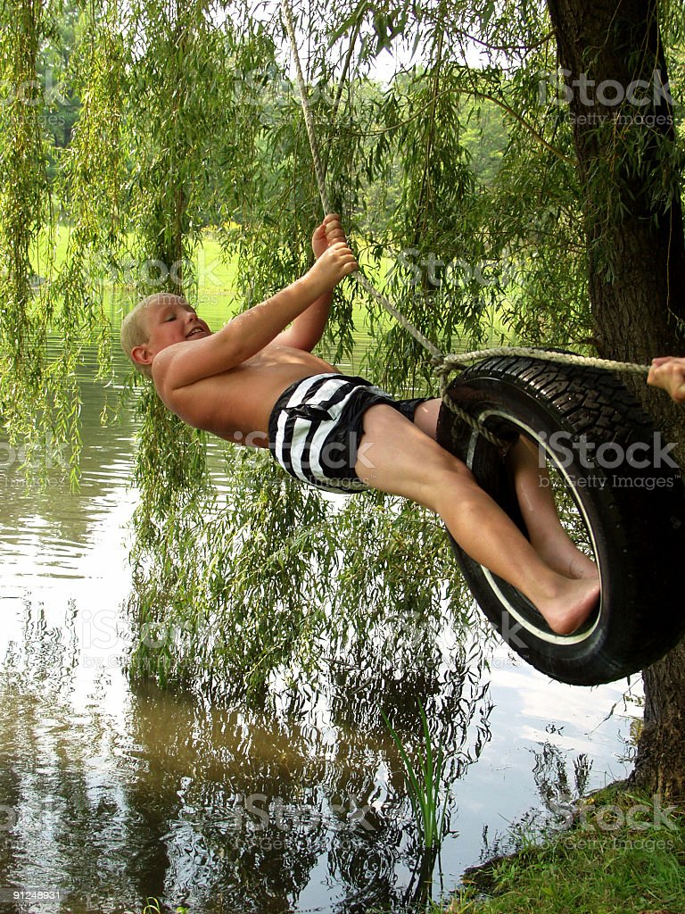 Summer Fun on the Tire Swing 3 royalty-free stock photo