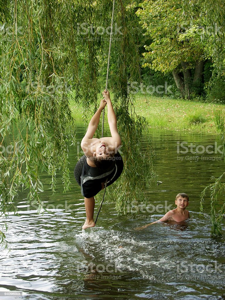 Summer Fun on the Tire swing royalty-free stock photo