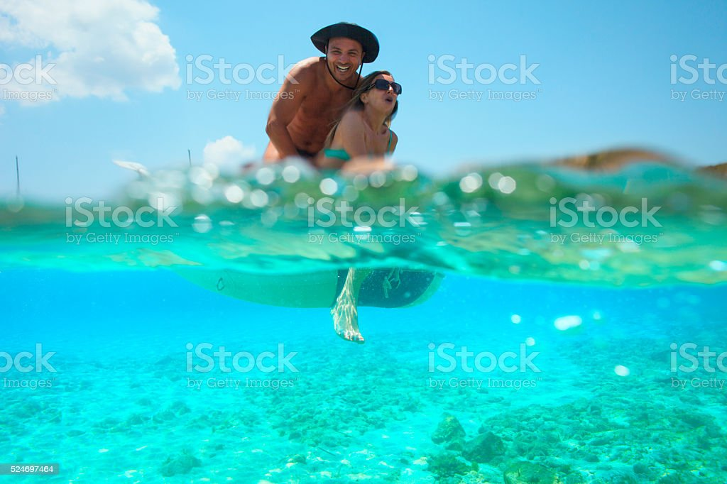 Summer fun  Romantic couple rowing dinghy  boat   Turquoise sea lagoon stock photo