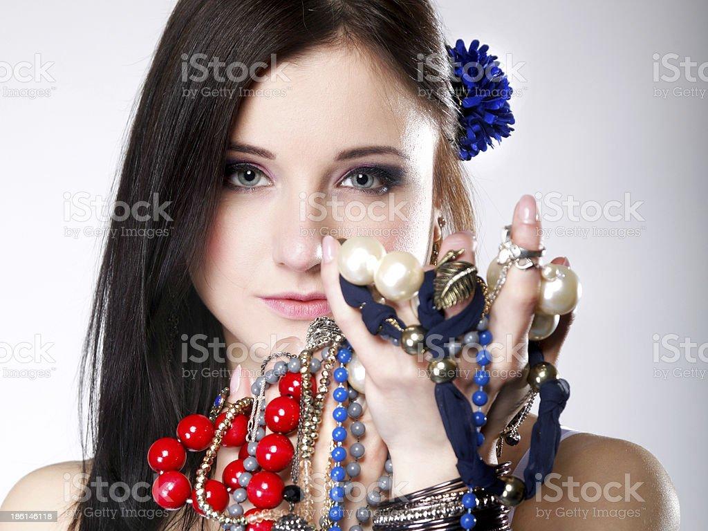 summer girl plenty of jewellery beads in hands royalty-free stock photo