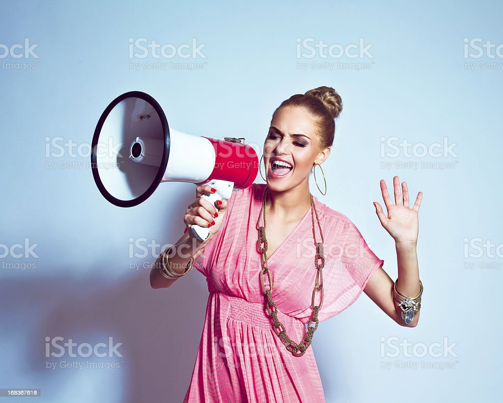 Summer Girl shouting into megaphone royalty-free stock photo