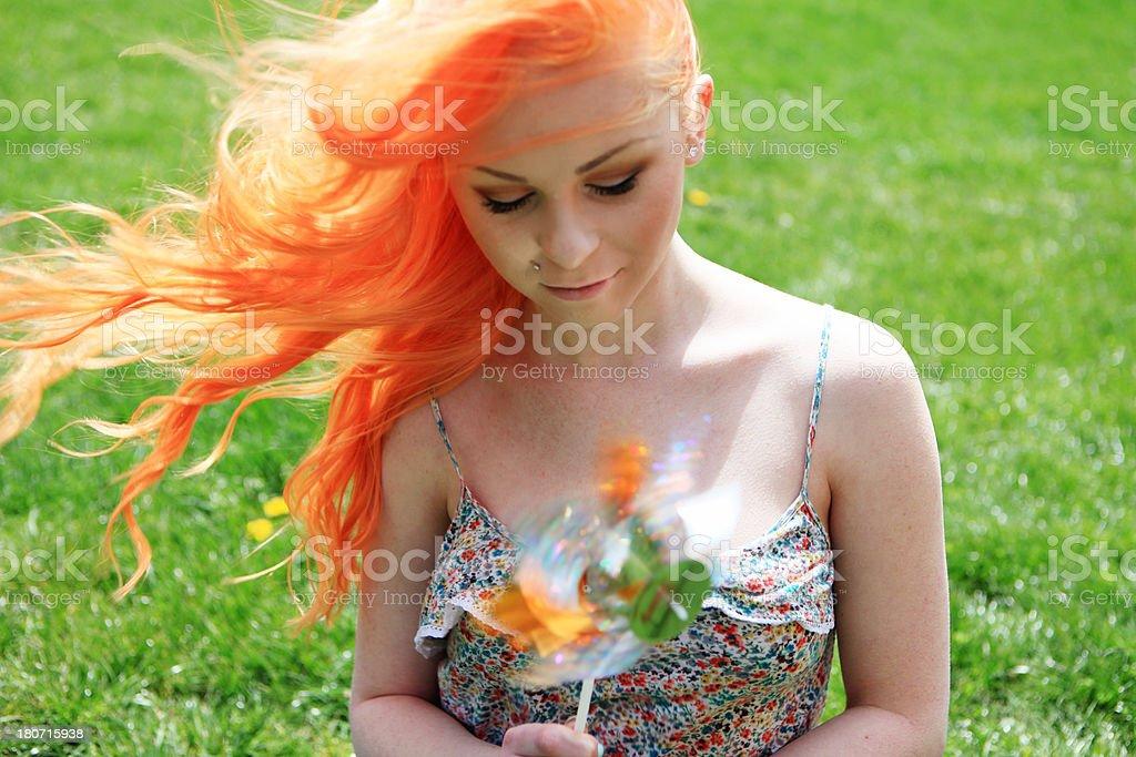 Summer girl with pinwheel stock photo