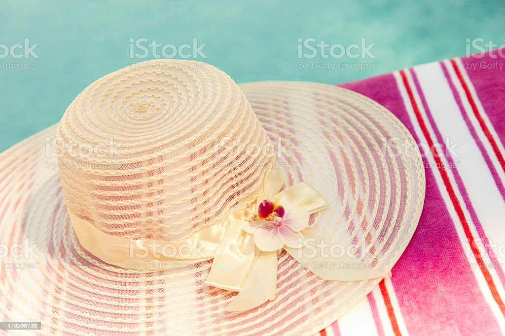 Summer hat by pool stock photo