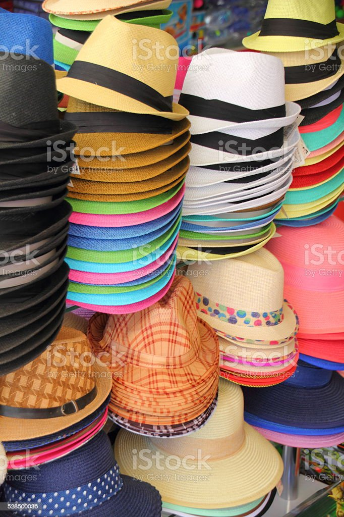 summer hats in a shop stock photo