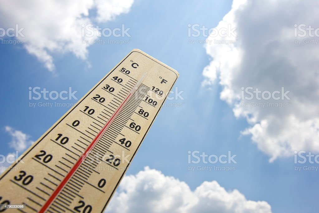 Summer heat shown on mercury thermometer stock photo