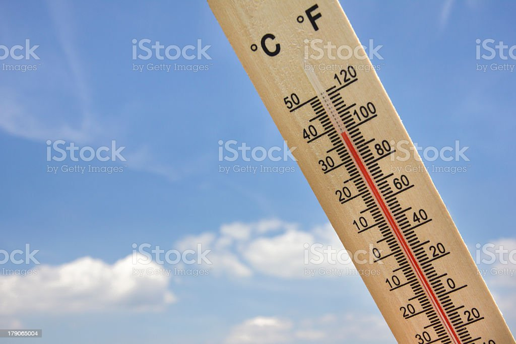 Summer heat wave shown on thermometer with 100 degrees Fahrenheit stock photo