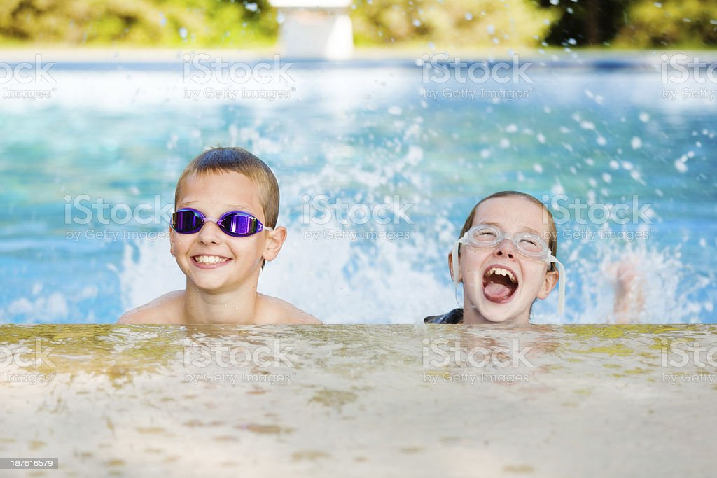 Summer Holiday Children Playing in Swimming Pool royalty-free stock photo