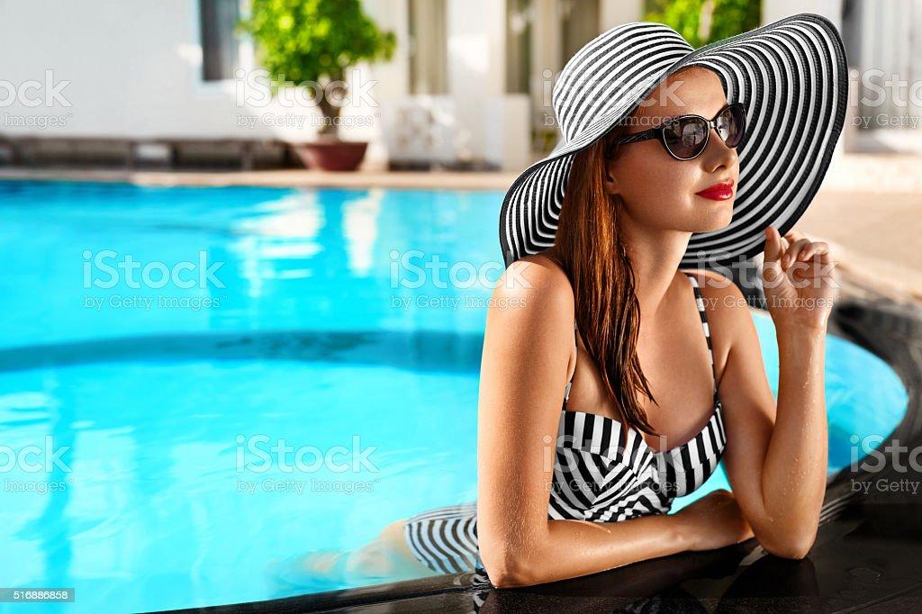 Summer Holidays. Travel Vacation. Beautiful Woman At Swimming Pool stock photo
