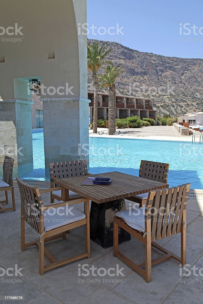 Summer hotel terrace with pool and outdoor furniture(Greece) royalty-free stock photo