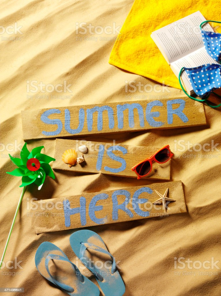 Summer is Here Sign on Wood in the Sand royalty-free stock photo