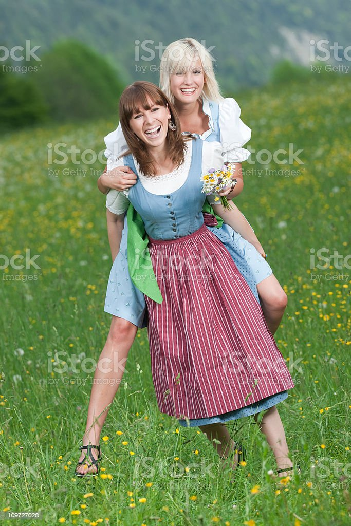 Summer Joy - best friends piggyback (XXXL) royalty-free stock photo