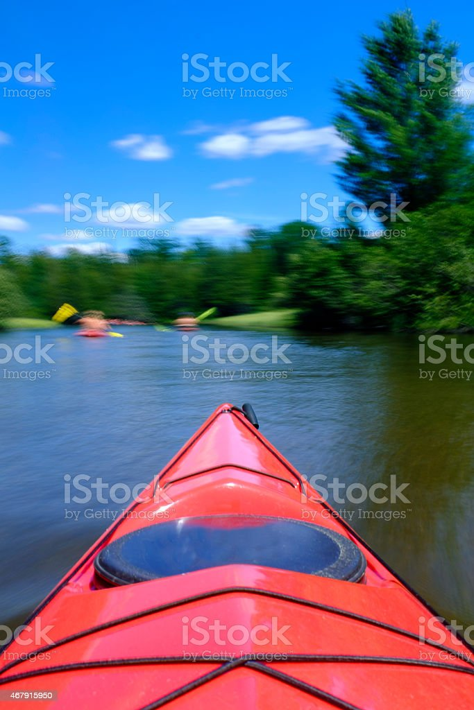 Summer Kayaking in a Red Boat stock photo