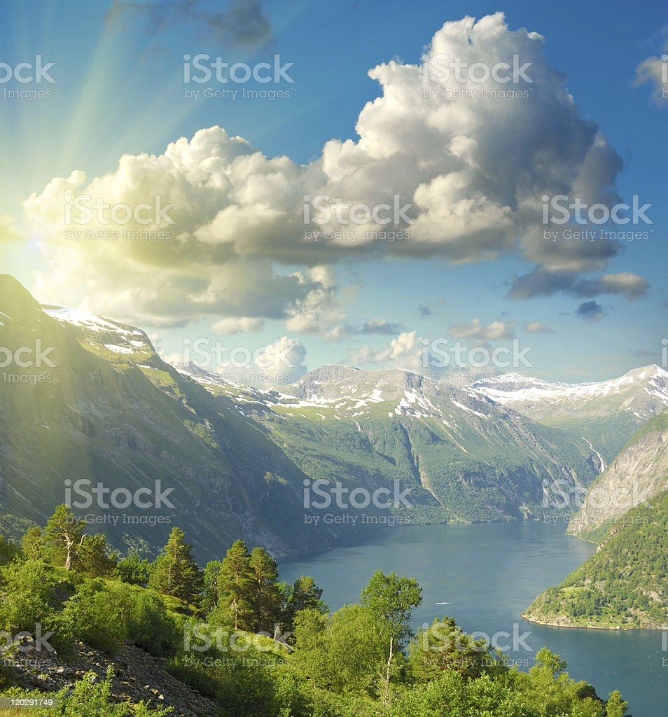 Summer landscape. Blue sky, mountains and fjord royalty-free stock photo