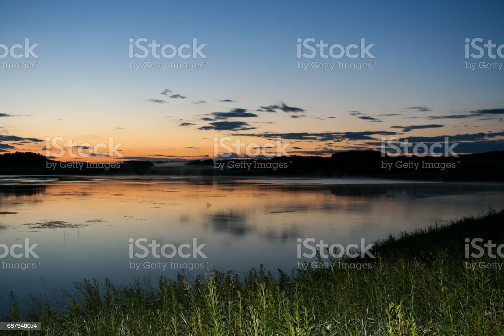Summer landscape. Evening sky and river after sunset. stock photo