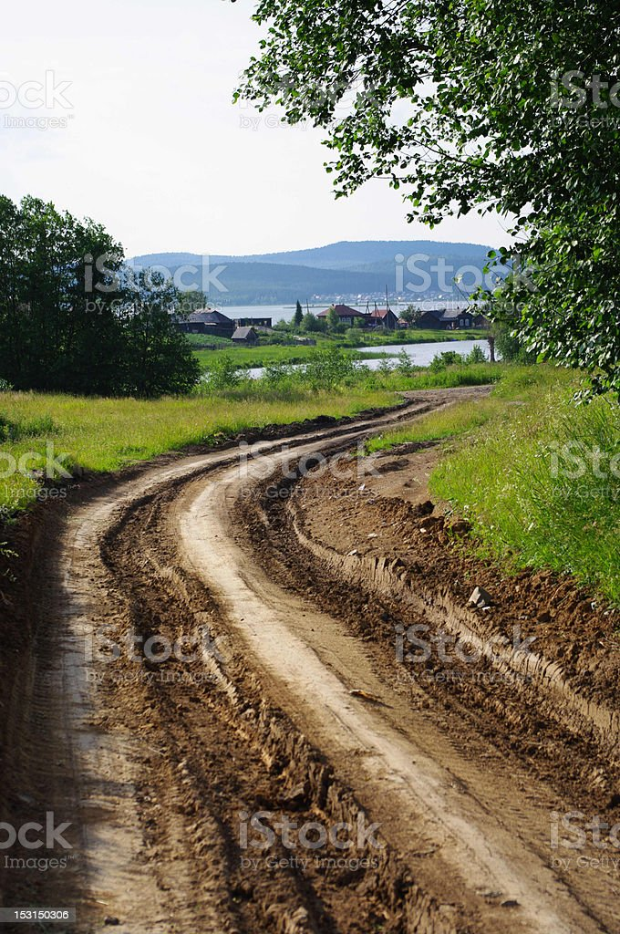 Summer landscape with a dirt road royalty-free stock photo
