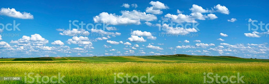 Summer landscape with clouds and blue sky stock photo